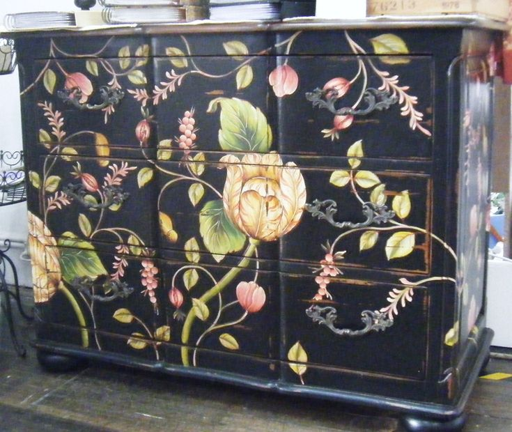 hand painted chest, I have a black antique dresser I could paint on.  Show this to Kate for a girls room?  Cool...
