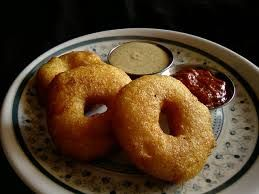 Indian Vadas. Vadas can vary in shape and size, but are usually either doughnut- or disc-shaped and are between 5 and 8 cm across. They are made from Black Gram and Bengal Gram. Also called the Indian version of donuts. :)