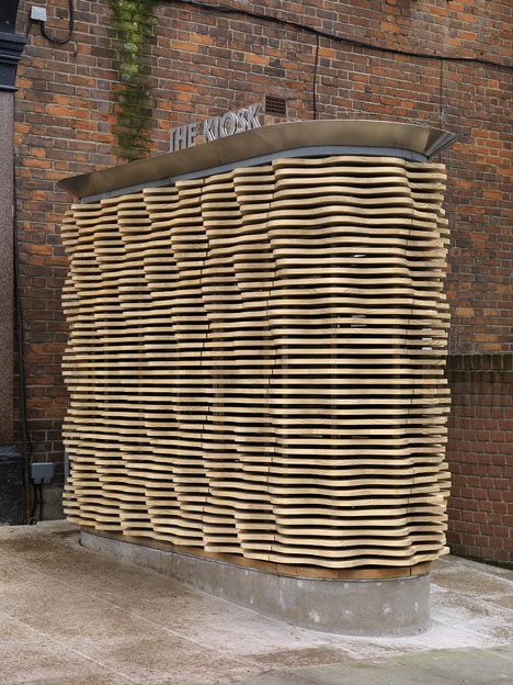 Undulating timber slats surround this London flower kiosk by Buchanan Partnership
