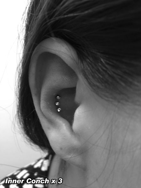 triple inner conch piercing -