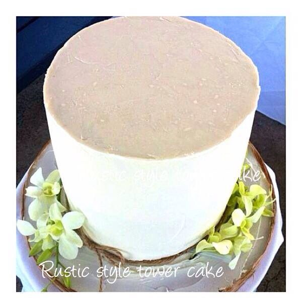 White ganached tower cake with fresh flowers...2 cakes 1 tier..