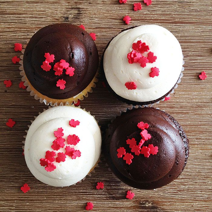 Happy Canada Day cupcakes with maple leaf sprinkles. By Bake Sale Toronto.