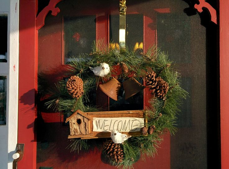 Rustic Winter Christmas wreath! The adorable little birds pair well with the rusty bells and birdhouse welcome sign!