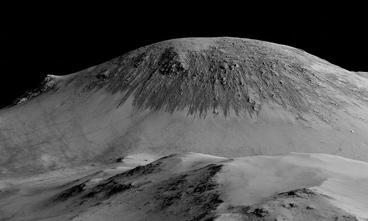 Researchers say discovery of stains from summertime flows down cliffs and crater walls increases chance of finding life on red planet