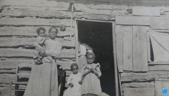 Unknown family outside their home. West Hants Historical Museum collection, Windsor.