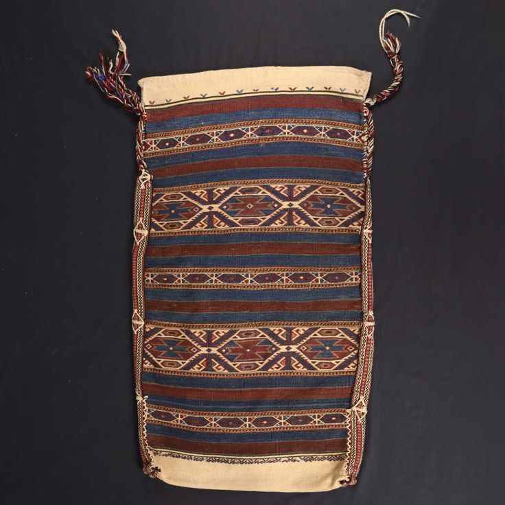 Bag used for food storage, hanging within the tents, or for food transportation. Only the exposed side is finely woven with the traditional motifs of Anatolian kilims. Size: 116 x 66 cm.