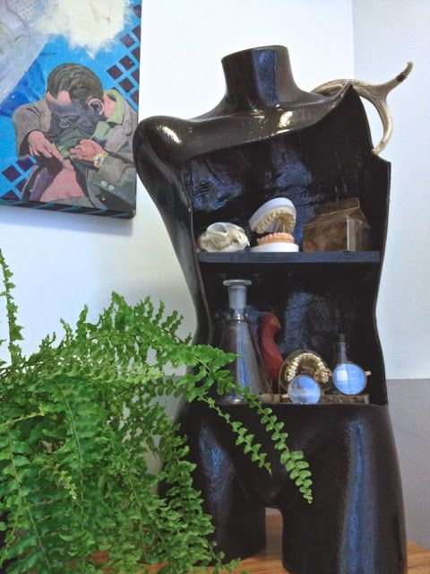 An old mannequin re-purposed into a curiosity shelf - LOVE IT