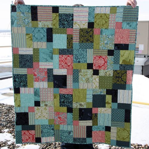 Disappearing Nine Patch Charm Pack quilt - made with three charm packs, just smaller than a lap quilt.