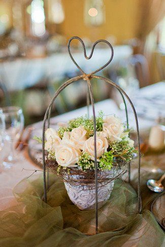 Rustic cream and green rose wedding table centrepiece decor  For more insipiration visit us at https://facebook.com/theweddingcompanyni or http://www.theweddingcompany.ie