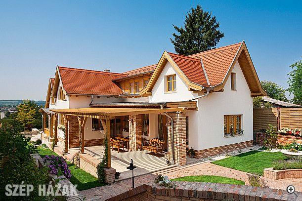 Az oldalhatárra épült háromszintes, organikus stílusú családi ház kívülről látványos, belül pedig visszafogottan berendezett.