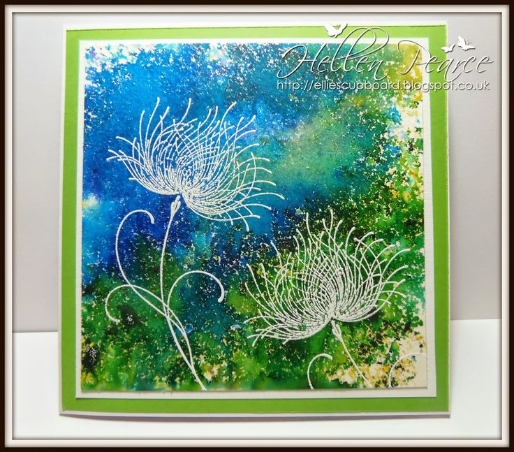 """By Hellen Pearce. Uses """"Brusho"""" -- a product containing crystals of watercolor which disperse when you add water. Stamp """"Dreamy"""" by Penny Black is stamped in VersaMark and heat embossed with white powder."""