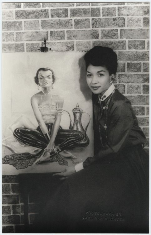 Lady Bird Cleveland, mother of legendary model Pat Cleveland photographed by Carl Van Vechten on November 16, 1954 with her painting in oil of Eartha Kitt.