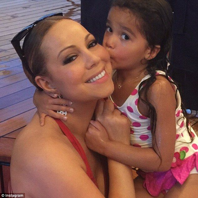 Mermaids! Sexy mama Mariah Carey posted a photo on Instagram with her cute four-year-old daughter Monroe giving her a kiss on the cheek after a dip in the ocean in Cannes, France on Thursday