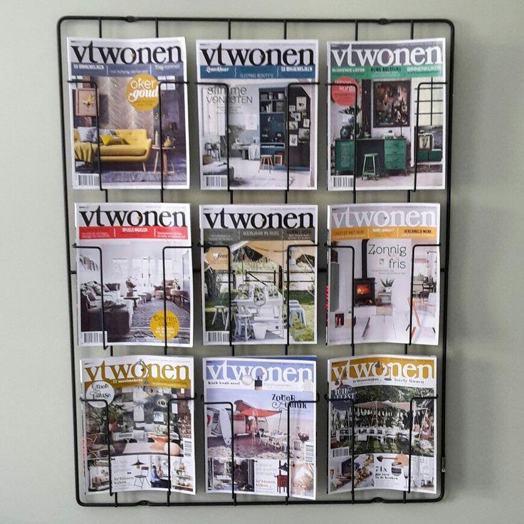 Pullman tijdschriftenrek met vtwonen aan de muur.  (Kleur = Zorgvuldig van Histor)