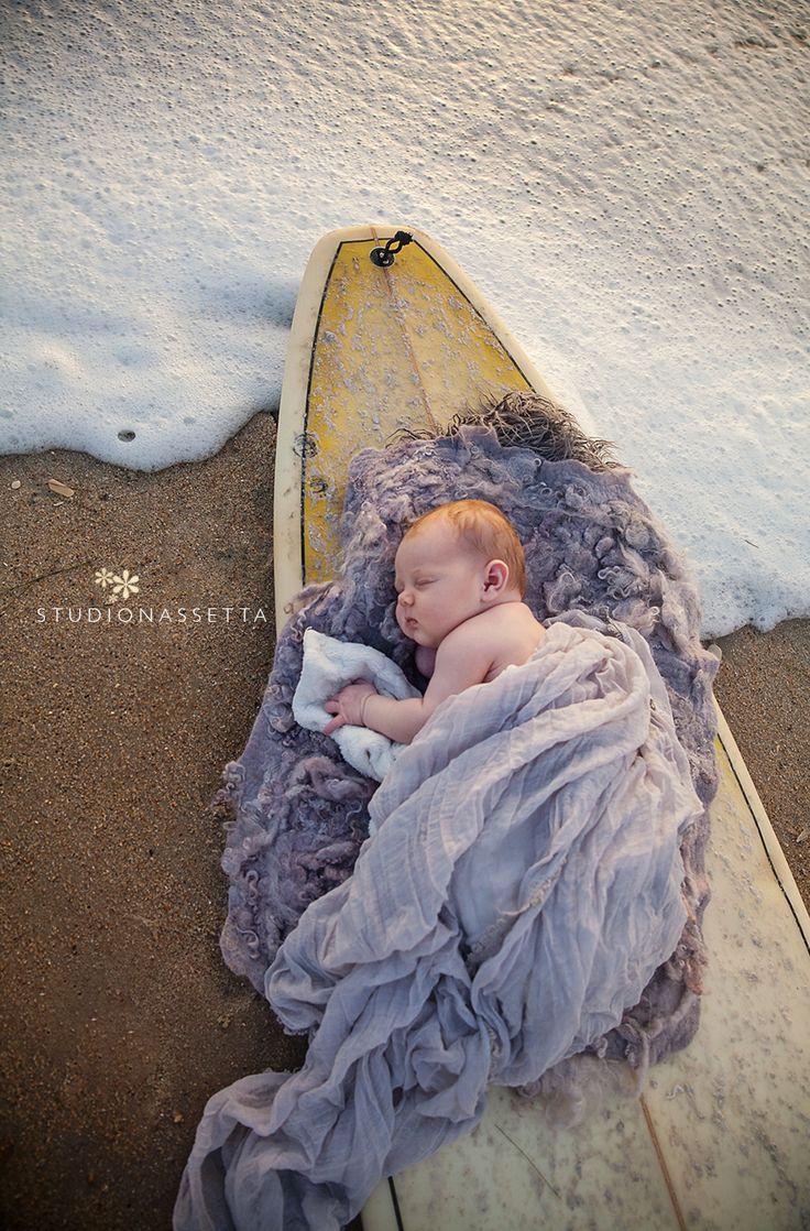 newborn baby on surfboard. studio nassetta photography & design: in nags…