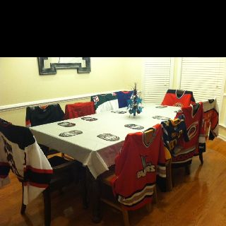Hockey jerseys are a great way to decorate the backs of chairs for a NHL party.