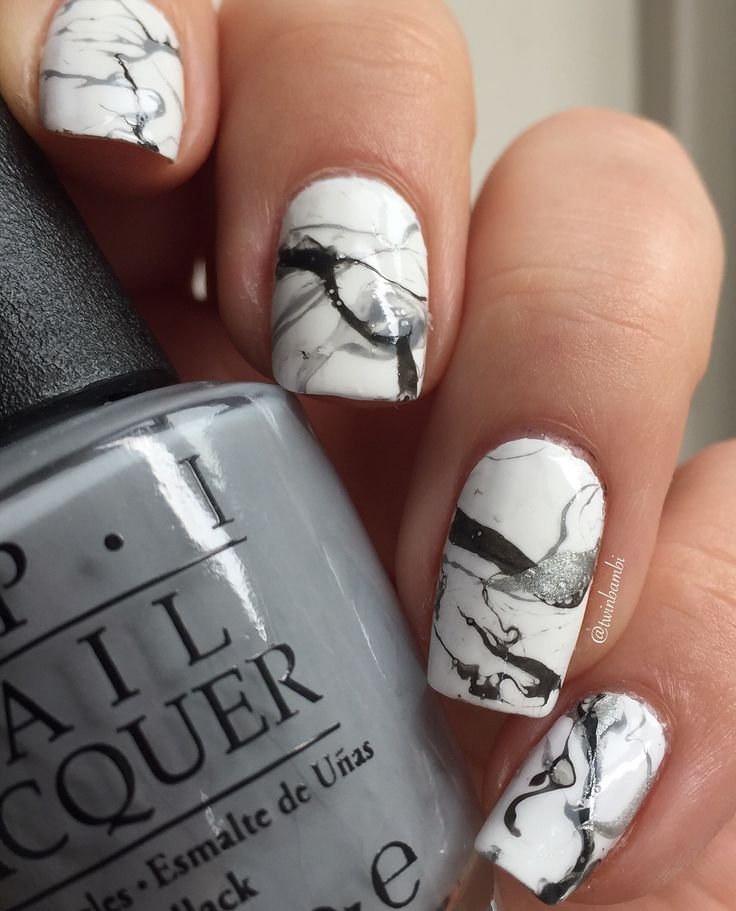My grey marble/water spotted nails.  Polishes used: Color Club French Tip and OPI My Silk Tie, Dark Side of the Mood and Cement The Deal.