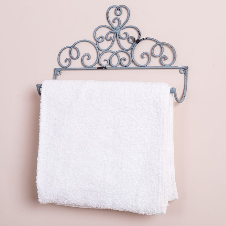 A pretty grey wall mounted towel rail