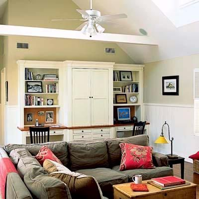 Dual work stations flank the media center in this multipurpose great room. | Photo: Dominique Verillon | thisoldhouse.com