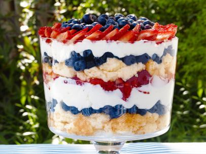 """RED, WHITE, BLUEBERRY TRIFLE: ¼ C + ⅔ C sugar, ¼ C fresh lemon juice, ¼ t almond extract, 1 angel food cake cut into 1"""" slices, 1 lb cream cheese @ room temp, 2 C heavy cream @ room temp, 2 pints blueberries, 2 pints hulled sliced strawberries, Trifle Dish {a must!!} • See Page for Directions"""