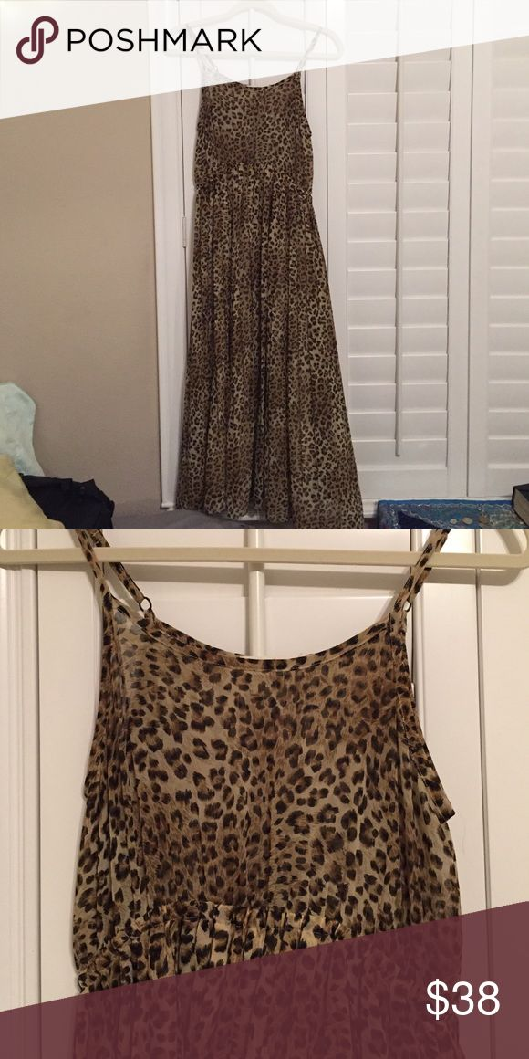 Long sheer cheetah dress with spaghetti straps Long sheer cheetah print dress with spaghetti straps, fitted top then flows out, cream slip underneath Nordstrom Dresses Maxi