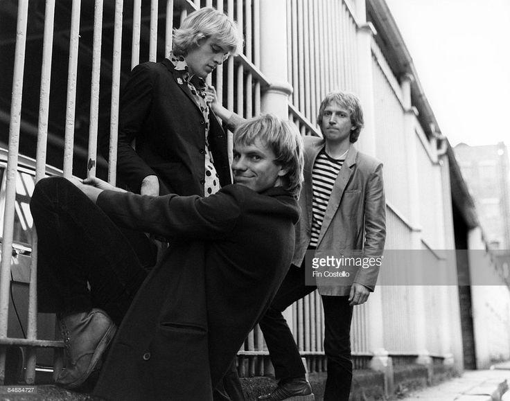 Photo of STING and Andy SUMMERS and Stewart COPELAND and POLICE; L-R: Stewart Copeland, Sting (front), Andy Summers. 'Walking on the Moon' cover session in London in September 1979.