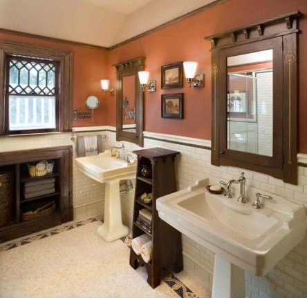 While oak trim and off-white subway tile are standard in many Arts & Crafts baths, this one gains depth from terra-cotta walls and the artfu...