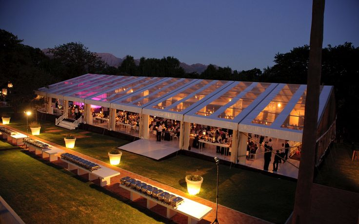 The sun sets on a magnificent Cape winelands celebration! Marquee by Wedding Concepts #winelands #capetown #destination #luxury #wedding #lighting #marquee