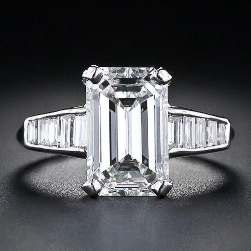 3.18 Carat Emerald Cut Diamond with Baguette Platinum Mounting