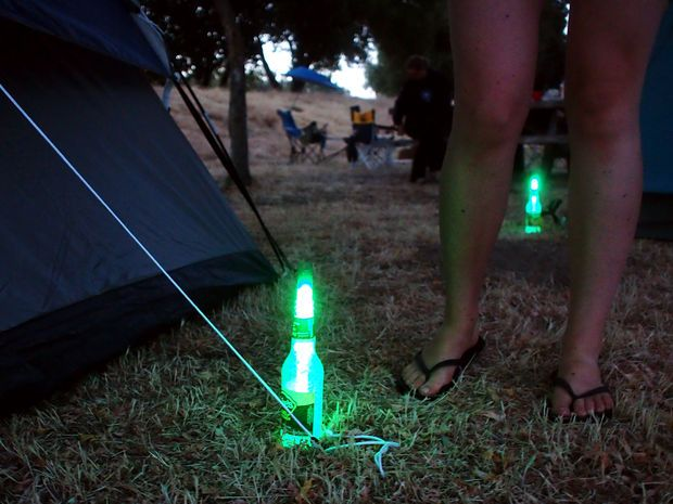 Mark tent stakes or a pathway with bottles and glowsticks. Coat the inside of the bottles with salt for better light diffusion.