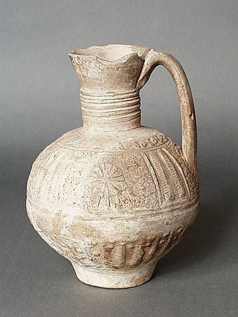 Ewer Greater Iran (Afghanistan) Ewer, 12th-14th century Ceramic; Vessel, Fritware, unglazed, molded, Height: 8 5/16 in. (21 cm); Diameter: 5 9/16 in. (14 cm) Gift of Kate Fitz Gibbon and Andrew Hale (AC1997.253.2) Art of the Middle East: Islamic Department.