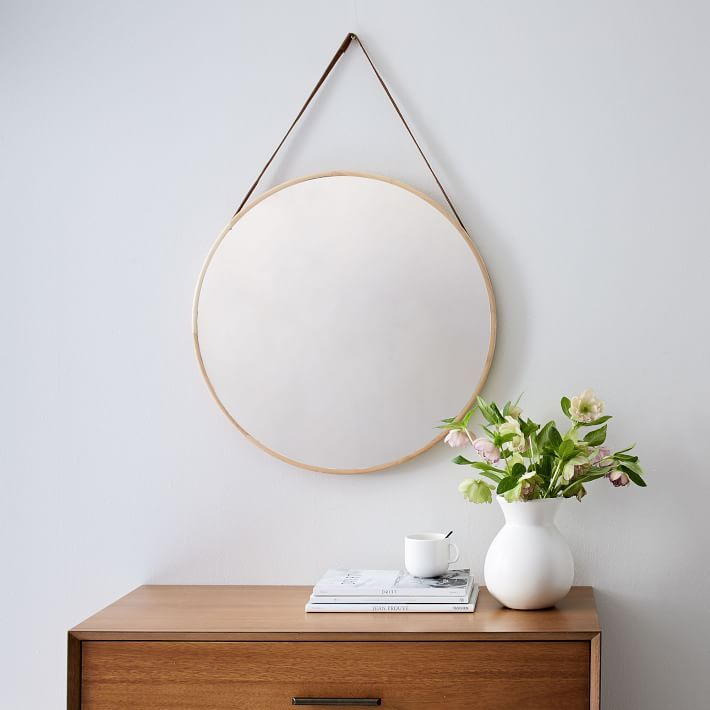 Taking cues from classic captain's mirrors, we gave our Modern Hanging Mirror a wooden peg and a decorative faux leather strap for a reflection that's extra handsome. D-rings located on the back keep the mirror safely in place.