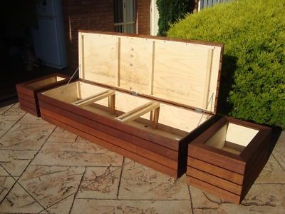 Merbau outdoor storage bench seat, planter boxes & screens.