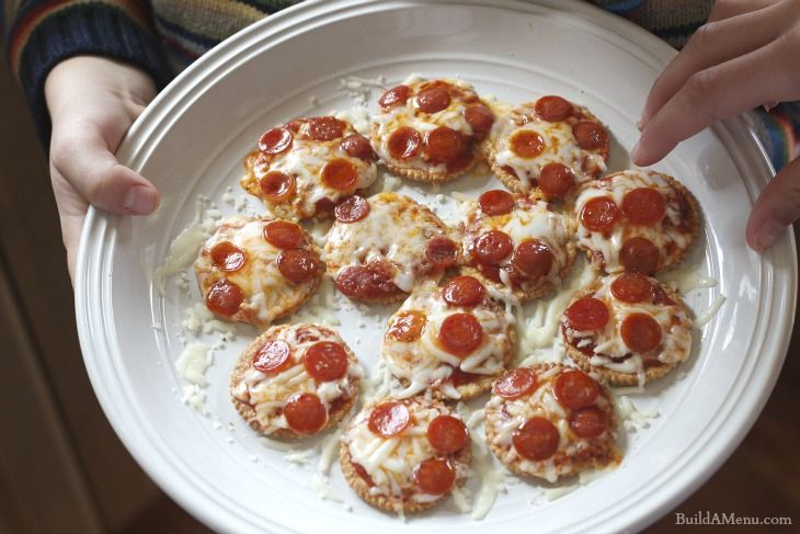 Pizza Crackers!! Ingredients:     Whole wheat Ritz crackers     ¼ cup pizza sauce     ½ cup mozzarella (shredded) cheese     1 package pepperoni minis (or any toppings)  Instructions:     Lay crackers on microwaveable plate.     Put about a teaspoon of sauce on each cracker.     Sprinkle mozzarella cheese on the sauce.     Place mini pepperonis on top of the cheese.     Microwave plate for 45 seconds or until cheese is melted.