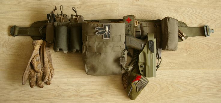 """HSGI Cobra Riggers belt (No D-ring) First Spear Pistol Magazine Pocket, Single, Speed Reload (Glock 17/19) 2 * Tactical Tailor 5.56 Single Mag Pouch 30rd 2 * Blue Force Gear Ten-Speed Single M4 Pouch Tyr Tactical Dump Pouch (Molle) Marz Tactical Tourniquet Pouch + Tier-One Quality Solution Military Emergency Tourniquet Gemtech Tactical Retention Lanyard Original S.O.E. Combat Cock G-Code XST RTI Kydex Holster (Glock 17/22/31) + G-Code RTI Duty Mount Kydex Belt-Slide 1.75"""" Benchmade SOCP…"""