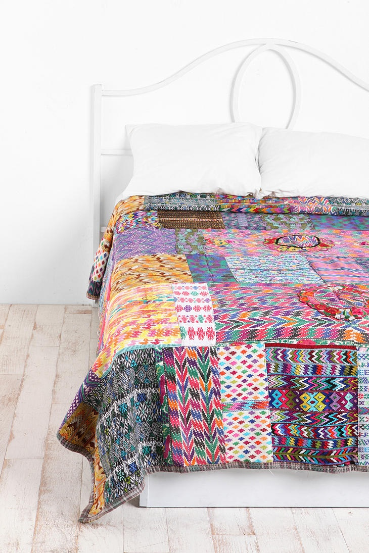 A DIY project? My grandma used to make patch-work duvets when I was small, and my mother still has one. It's not very ethnic though - all the fabrics were Finnish from the 70's. But I would love to make something like this!