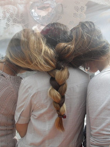 3 girls 1 braid  hair braided tied or stuck together