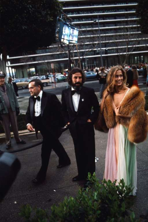 Oscars Red Carpet: The 25 Most Daring Dresses of All Time:      Lauren Hutton at the 47th Annual Academy Awards wearing a multi‐colored Halston gown with fur coat.  LOS ANGELES,CA ‐ APRIL 8,1975: Actress Lauren Hutton and Record producer Lou Adler arrive to the 47th Academy Awards at Dorothy  Chandler Pavilion in Los Angeles,California. ﴾Photo by Michael Montfort/Michael Ochs Archives/Getty Images﴿