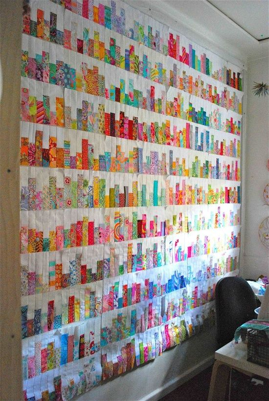 quilt assembled curtain/ throw made from quite small offcuts or scraps of fabric ... nice idea ... nicely done
