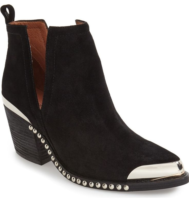 Polished studs and metallic hardware highlight the Western-inspired silhouette of a block-heel bootie modernized with breezy open-side construction.