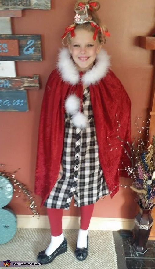 Amy: My daughter Abby is Cindy Lou Who from Whoville: Movie The Grinch. We made her costume with material from JoAnn fabrics, and I did her hair and make up myself....