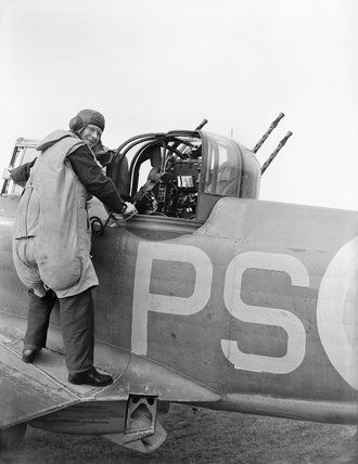 An air gunner of No. 264 Squadron RAF about to enter the gun turret of his Boulton Paul Defiant Mk I at at Kirton-in-Lindsey,