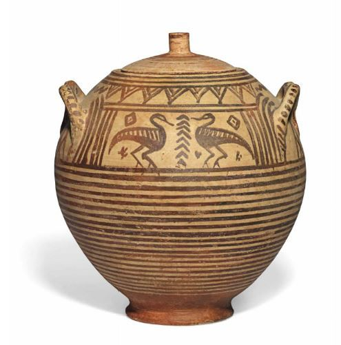 Italo geometric pottery pyxis and lid, early 7th century B.C. The ovoid vessel with stylised handles in the form of horned animal heads, each side with a central panel with a pair of confronting water fowl, a stylised branch between, band of inverted triangles above, horizontal bands above and below, the knobbed lid with concentric circles, 28 cm high. Private collection