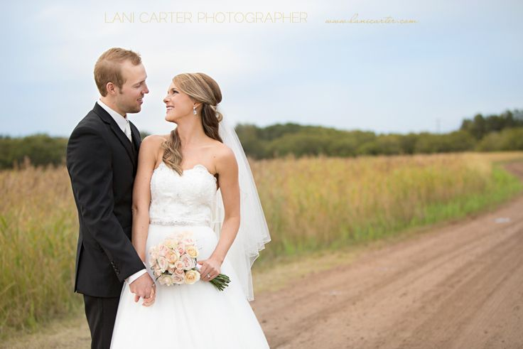 Bride and groom on a dirt road. www.lanicarter.com