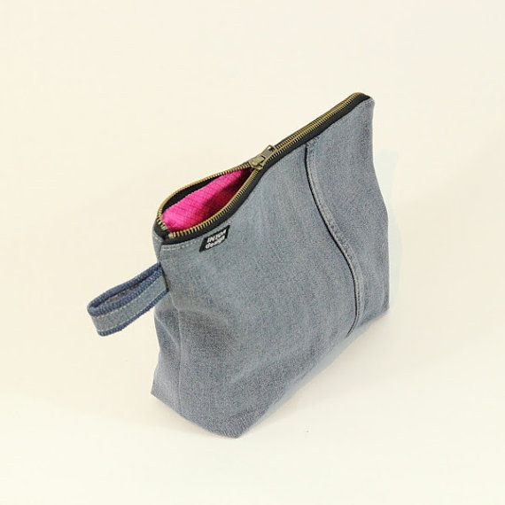 Large toiletry bag made of recycled jeans with a metal zipper. The lining is of recycled cotton fabric and its color/pattern varies depending on available materials. You can select a lining color when adding to cart or you can select Custom Color and specify your custom color/pattern
