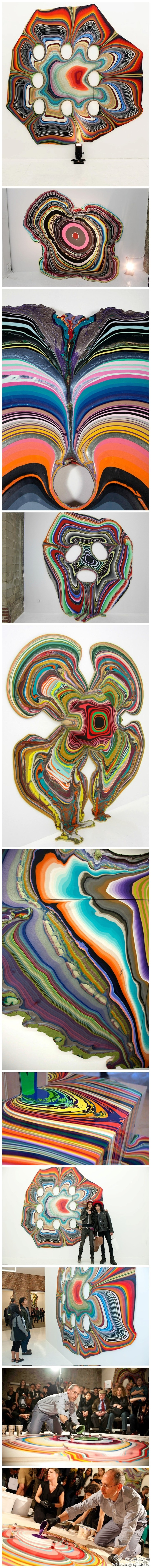 """Ambilight """"inverted"""" painting, the artist Holton Rower of the Kremlin in the same plane, the various colors of paint layer by layer, pouring up to become a colorful geometric works of art."""