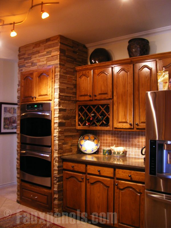 Double Oven On Stone Wall Kitchen Remodeling Ideas