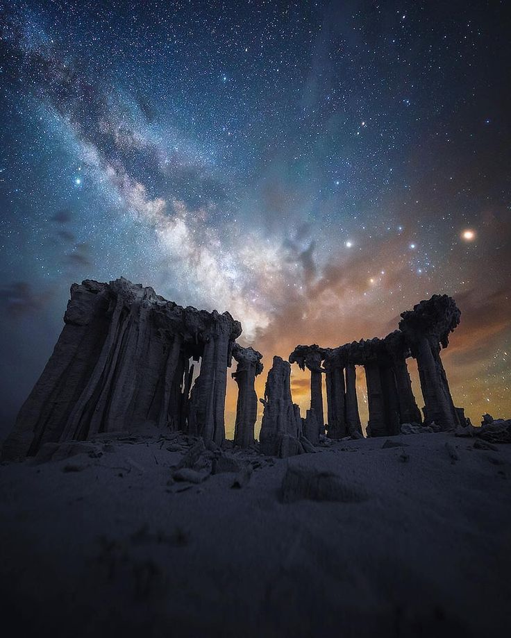 """presents the  N I G H T S C A P E R Photo Award to ... .  @shainblumphotography . .  Location: Somewhere in the Eastern Sierras, California. Congratulations to Michael Shainblum. """"What Still Remains,"""" is Michael's title for this image. Some have asked: """"Are these the starlit ruins of an ancient civilization?"""" Michael's clever silence only adds to the mystery, as hundreds of comments pour into... (""""I think that's PetrifiedTreeHenge, an ancient alien waypoint to a landing site,"""" says…"""