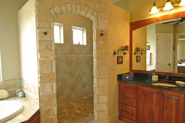 Walk In Shower, no door.  http://www.marshillpropertymanagement.com/wp-content/uploads/2011/01/stone-walk-in-shower.jpg
