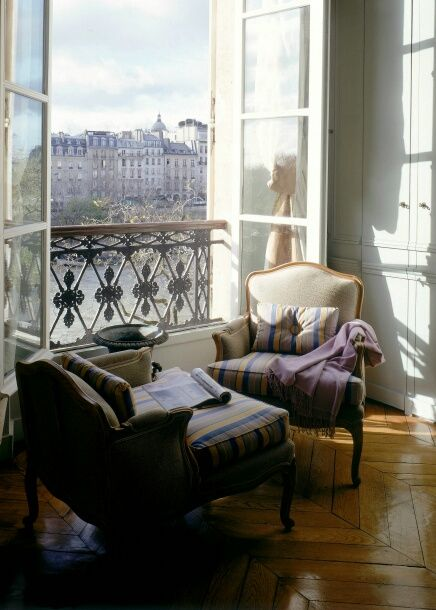 just once in my life—even for just a night—I wish to stay in a Parisian apartment with windows like this and a view to go with them…